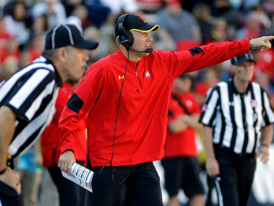 Maryland head coach DJ Durkin directs his players in the second half of an NCAA college football game against Minnesota in College Park, Md., Saturday, Oct. 15, 2016. Minnesota won 31-10. (AP Photo/Patrick Semansky)