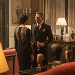 """In this image released by Metro-Goldwyn-Mayer Pictures/Columbia Pictures/EON Productions, Monica Bellucci, left, and Daniel Craig appear in a scene from the James Bond film, """"Spectre."""" The movie releases in U.S. theaters on Nov. 6, 2015. (Jonathan Olley/Metro-Goldwyn-Mayer Pictures/Columbia Pictures/EON Productions via AP)"""
