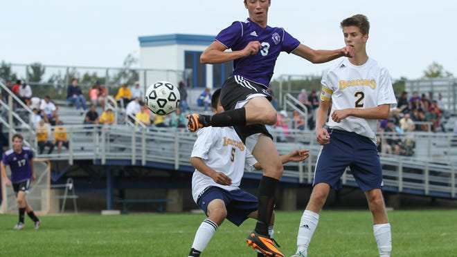 Jon Cooney of Lakeview plays a volley toward the goal against Battle Creek Central in the All-City championship game.