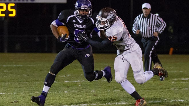 Lakeview's Dre'On Kemp runs past Zak DeVera of Portage Northern in the Spartans' playoff win on Friday.