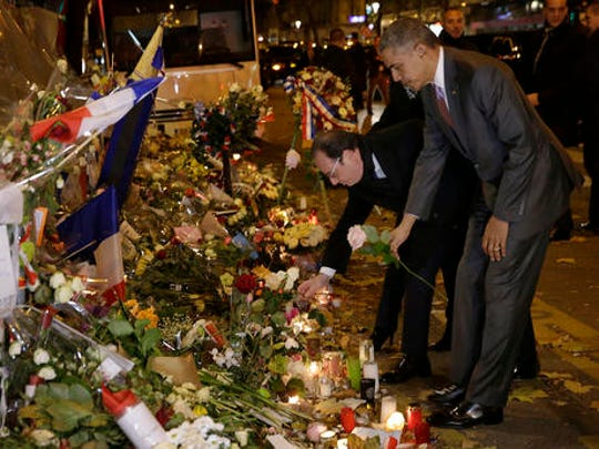 "FILE - In this Monday, Nov. 30, 2015 file picture, U.S. President Barack Obama, right, and French President Francois Hollande pay their respect at the Bataclan concert hall, one of the recent deadly Paris attack sites, after Obama arrived in the French capital, Paris, to attend the World Climate Change Conference 2015 (COP21). French President Francois Hollande says he decided against running for another term because he wants to give his Socialist party a chance to win ""against conservatism and extremism."""
