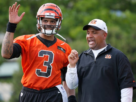 Fourth-year quarterback Terrell Pryor talks to Cincinnati Bengals offensive coordinator Hue Jackson during rookie camp, Friday on practice fields near Paul Brown Stadium in Cincinnati, Ohio.