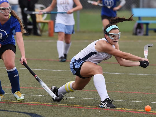 Capes Tess Bernheimer makes a shot to goal as Cape Henlopen High School (white) hosted Brandywine HS (blue) in the 1st round of the Delaware State HS Hockey Tournament at the school near Lewes on Wednesday November 11.