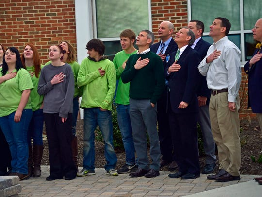State legislators pledge the American flag with with students at Franklin County Career and Technology Center. The legislators toured the school Thursday, March 17, 2016.