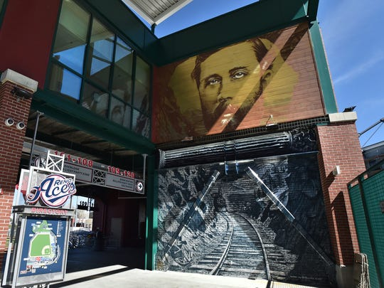 Artist Erik Burke painted a mural opposite Bryce Chisholm's mural inside home plate entrance of the Greater Nevada Field, home of the Reno Aces.