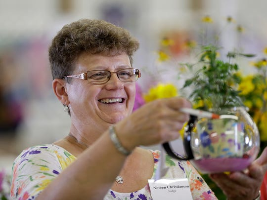 The Brown County Fair is getting ready for the 2016 edition August 16, 2016. Although the animal contests begin Wednesday, 4-H floral judge Noreen Christianson evaluates a flower arrangement entry Tuesday.