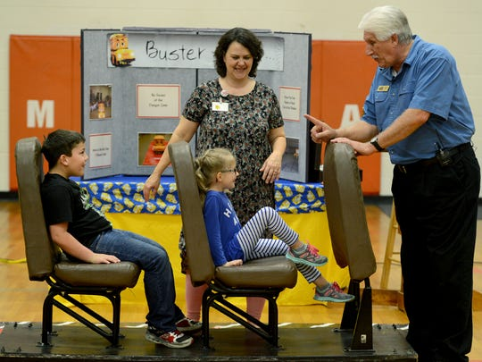 Bryan Nash gives instructions to Medina Elementary School second graders Andrew Reifsnider and Reece Kerfoot on Wednesday morning. Students learned about school bus safety.
