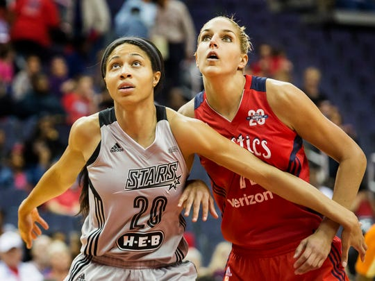 Washington's Elena Delle Donne fights for position on a rebound with San Antonio's Isabelle Harrison (No. 20) in the first half of the Washington Mystics' 89-74 win over the San Antonio Stars at the Verizon Center in Washington, D.C. on Sunday afternoon.