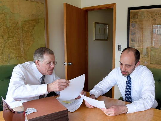 Ithaca attorneys Ray Schlather, left, and Jake McNamara, right, in the offices of Schlater, Stumbar, Parks & Salk, LLP.