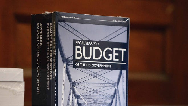 Copies of President Barack Obama's proposed 2016 federal budget are delivered to Capitol Hill in February.