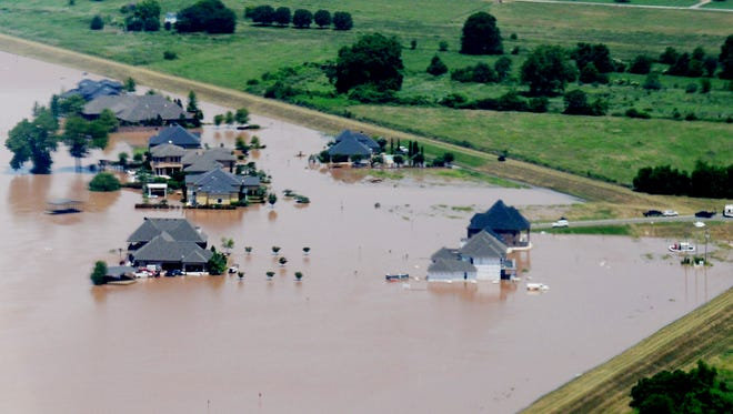 The homes of the River Bluff Subdivision in North Bossier  are covered by water Friday afternoon.