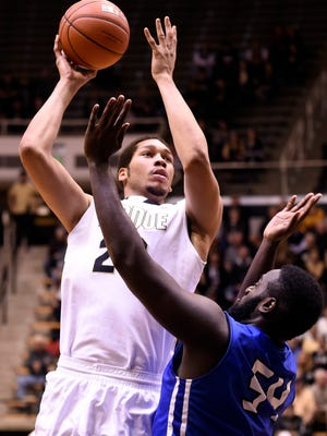 Purdue center A.J. Hammons (20) shoots over IPFW forward Steve Forbes in the second half of Purdue's 63-43 victory at Mackey Arena on Monday.