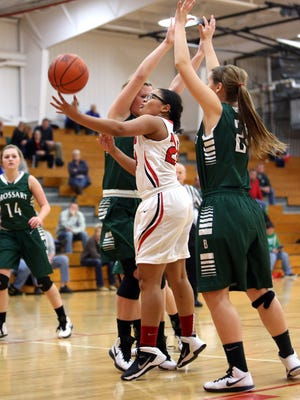 Beechwood's Kimi Stokes splits two defenders for a layup.