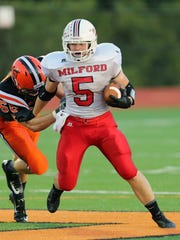 Milford running back Jack Young, along with his brother, Alex, has made a major impact on the 2014 Milford football team.