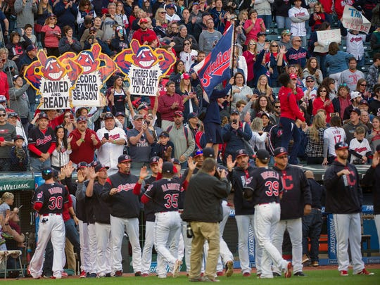 Cleveland Indians fans hold up signs at the regular