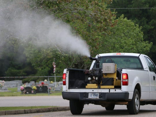 A Forrest County truck sprays mosquito repellent around the Dixie community in an attempt to minimize the number of mosquitos carrying the West Nile virus.