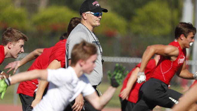 Brophy Prep's head coach Jon Kitna, a former NFL QB, coaches players at their first spring practice at Brophy Prep's field in Phoenix, Ariz. on April 23, 2018.