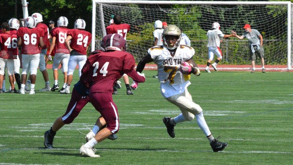 Clarkstown South receiver R.J. Lamarre gets into the