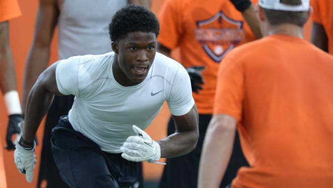 Tampa four-star athlete Ray-Ray McCloud works out at the Dabo Swinney Football Camp Tuesday June 10, 2014.