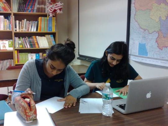 Simran Kaur and Huma Naqvi of Carteret, Chinese IV students at The Wardlaw-Hartridge School in Edison, draw a layout of the campus, marked in Chinese, for the student exchange visitors from Shi Shi High School in Chengdu, China, to use during their visit later this month. Chinese III students also wrote self-introduction emails, in English and Chinese, to their student exchange partners from Shi Shi High School, who will be making their first visit to W-H and staying with host families from Sept. 28 to Oct. 3.