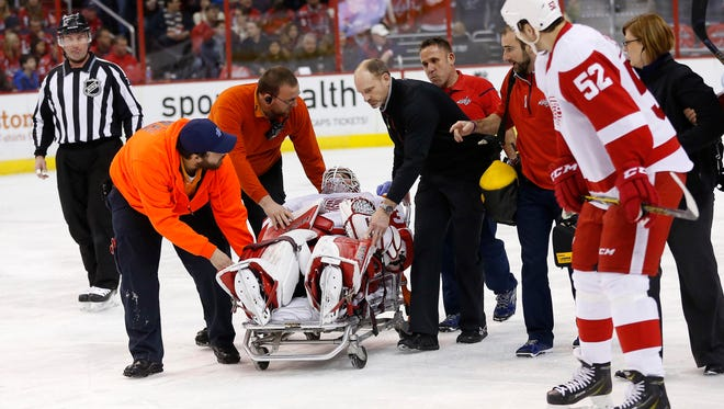 Detroit Red Wings goalie Jimmy Howard (35) is stretchered off the ice after a first-period goal.