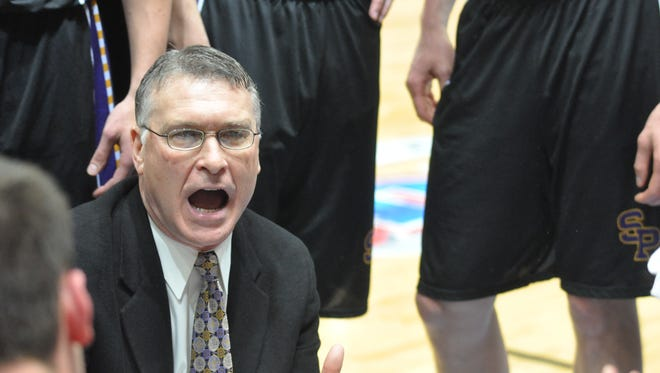 UW-Stevens Point head basketball coach Bob Semling spells out the strategy during a second half timeout in a 2015 Division III national semifinal.