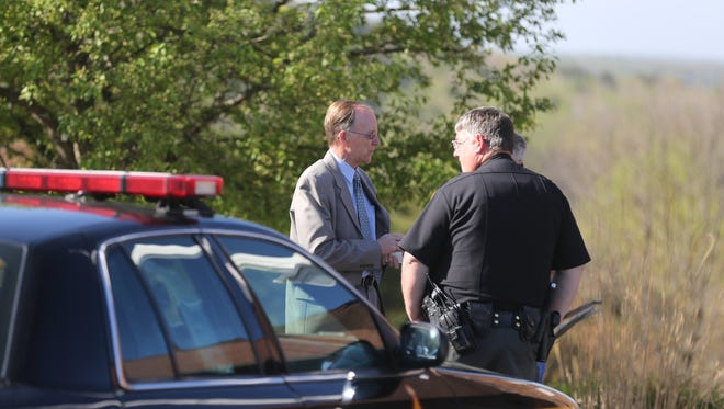 "Union Hill Pastor Phil Fulton talks with sheriff deputy outside the church. Fulton said, ""There are no words for this."""