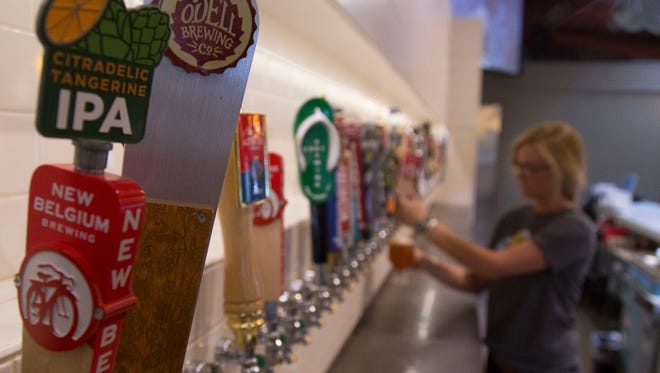 New Belgium and Odell brewing, two breweries who left the Colorado Brewers Guild, still have taps in numerous bars across the state Monday, September 12, 2016.