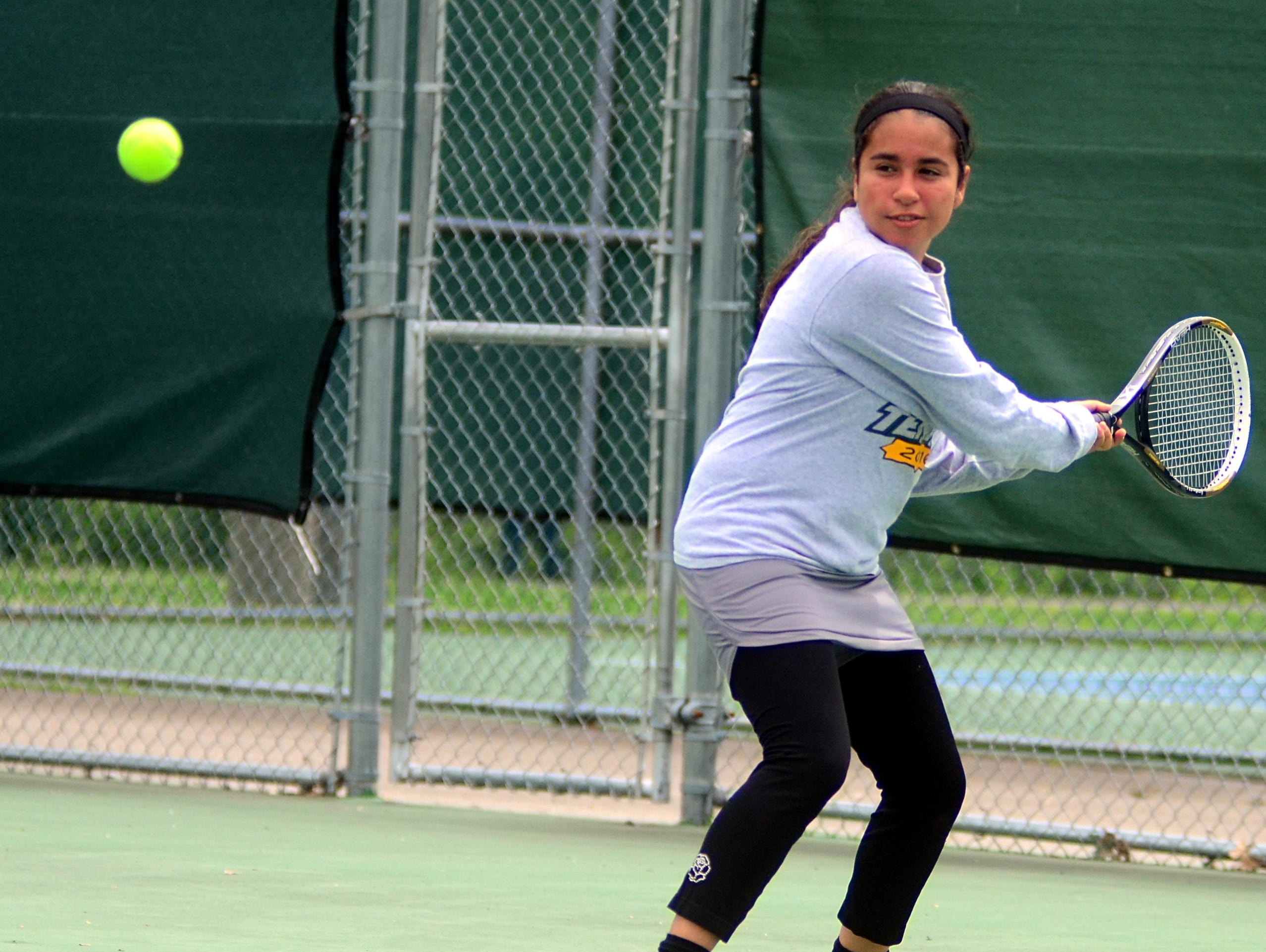 Gallatin High senior Erika Urena prepares to hit a backhand during Tuesday's District 9-AAA Individual Tennis Tournament. Urena suffered a straight-set loss in the first round of the singles tournament.