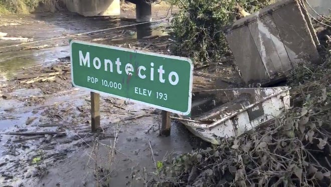 In this image from video provided by the Santa Barbara County Fire Department, Highway 101 remained underwater last January as cleanup crews worked to clear the roads after the Montecito mudslides.
