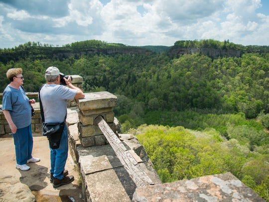 Visitors of the Red River Gorge take pictures after