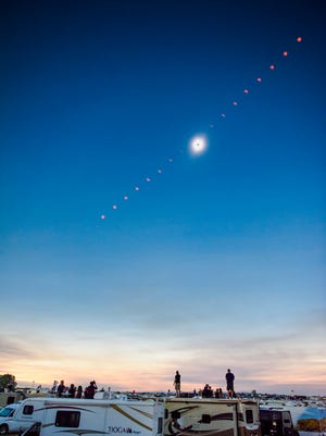 The progression of the total solar eclipse through the sky is seen in this composite photograph from Solartown, a solar eclipse campground, on Monday, Aug. 21, 2017, just north of Madras, Ore.