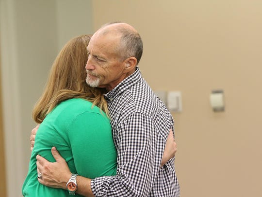 Natalie DiSabatino, 28, hugs father Tom after the two spoke to the media about the 2012 unsolved homicide case that involved her brother and Tom's son, Peter DiSabatino.
