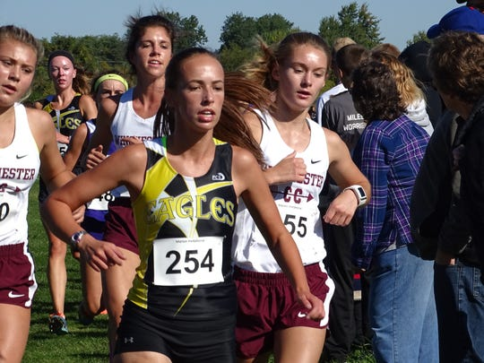 Anna Reffey makes the turn to cross the bridge at the