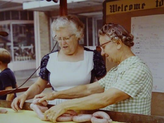 Women roll bratwursts during the 1968 Bucyrus Bratwurst