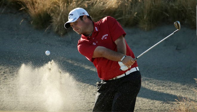 Patrick Reed hits out of the bunker on the 14th hole during the second round of the U.S. Open golf tournament at Chambers Bay on Friday, June 19, 2015 in University Place, Wash.
