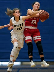 Appleton North's Anna Laux (10) defends against Kimberly's