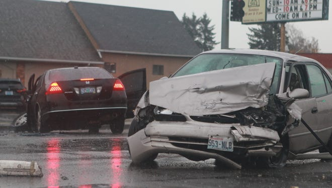 A man fleeing police in a stolen car crashed into two vehicles in northeast Salem, injuring another driver and leading officials to close a stretch of Portland Road NE Wednesday afternoon.