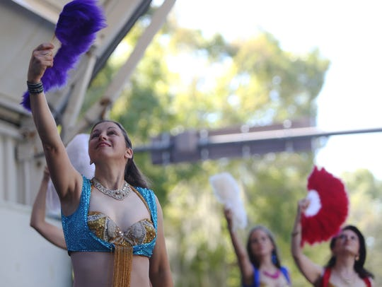 Performs with Troupe Arabesque, a Middle Eastern dance