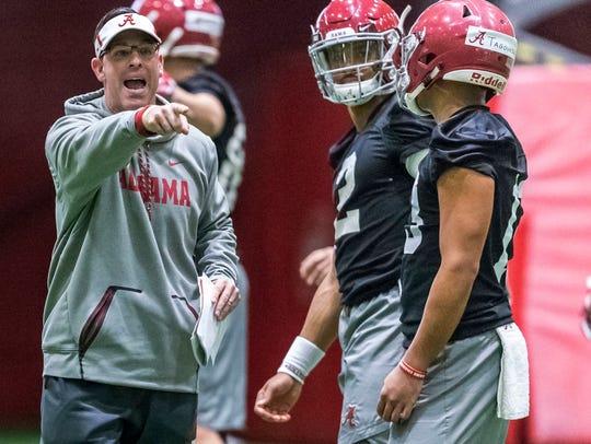 Alabama quarterbacks coach Dan Enos directs passing
