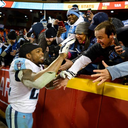 Titans running back Derrick Henry (22) celebrates with
