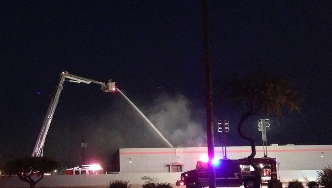 Dozens of fire crews responded to a blaze at a Tempe warehouse near McClintock Road and Loop 202 on Dec. 1, 2014.