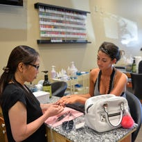 Natalie Tran, owner of the PaintBox Nail & Spa in St. Cloud, talks about her experience in different parts of the country Tuesday, July 26. She came back to St. Cloud to be close to her mother.