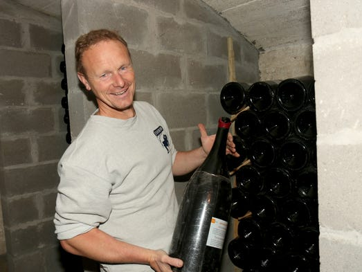 Cantillon brewmaster Jean Van Roy stores a 6-liter lambic in a bomb shelter in Belgium.