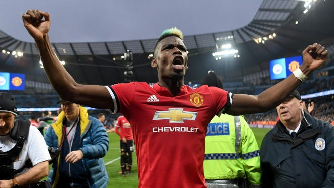Paul Pogba of Manchester United celebrates victory after the Premier League match against Manchester City at Etihad Stadium.