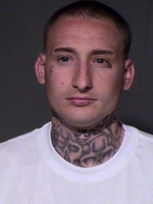 Gustin Ray Woodman is facing murder charges in the killing of a Valley church janitor.