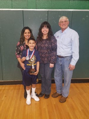 Aiden Rosado (front) of Vineland is joined by (back row, from left) his mother, Cicelia Colon, his grandmother, Aldis Sotomayor, and Joseph E. Romano, president, Vineland Elks Lodge No. 1422. Aiden, representing the Vineland Elks, placed second in the 8- to 9-year-old division of the New Jersey State Elks Hoop Shoot Free Throw Tournament in South Plainfield on Feb. 11. Aiden, a student at Max Leuchter School, made 20 out of 25 shots. For Vineland Elks information, call Joe Romano at (609) 774-8880.