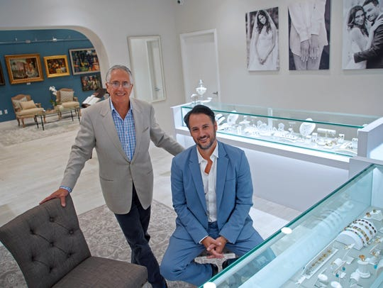 Owner Jim Stein and his son, Edward, a partner at Stuart Kingston Galleries, sit in the jewelry store and art gallery at the new Greenville location.