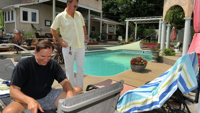 Ted Komacek, left, rents a room at Disgraceland Mansion in East Nashville from Patton James using the Airbnb service.