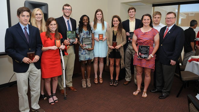 UL Student-Athlete of the Year nominees with University President Dr. Joseph Savoie (right) include (from left): Beau Robinson, Melissa Burckhartt, Anna Katherine Devitt, Dylan Moore, Kia Wilridge, Stacy Reilly, Lindsay Brammer, Steven Wronkoski, Shellie Landry and Haraldur Magnus. Not pictured are Edgar Lopez and Dominique Tovell.